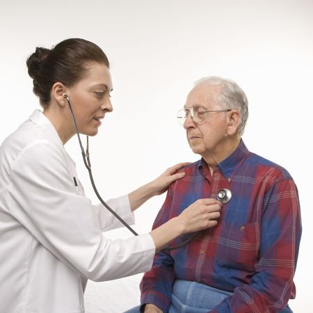 Mid-adult Caucasian female doctor listening  to elderly Caucasian male's heartbeat with stethoscope. Stock Photo - 1795526