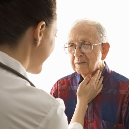 Mid-adult Caucasian female doctor checking an elderly Caucasian male's pulse. Stock Photo - 1795943
