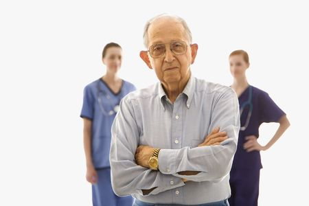 Elderly Caucasian male in foreground with two Caucasian females in the background. Stock Photo - 1795917