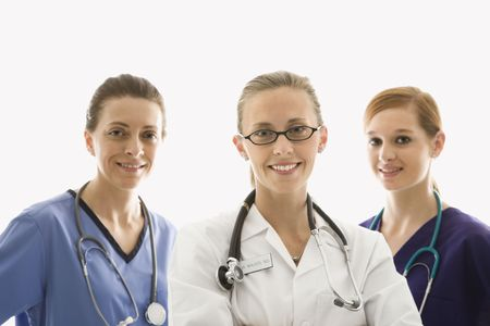 Portrait of smiling Caucasian women medical healthcare workers in uniforms against white background. photo