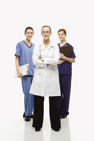 Full-length portrait of Caucasian women healthcare workers in uniforms standing against white background. Stock Photo - 1795908