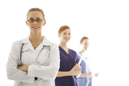 Portrait of smiling Caucasian medical healthcare workers in uniforms standing against white background. photo