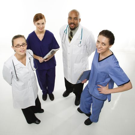 Full-length portrait of African-American man and Caucasian women medical healthcare workers smiling in uniforms standing against white background. Stock Photo - 1795915