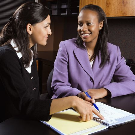 African-American and Indian young adult smiling business women working together in office. Stock Photo - 1796966