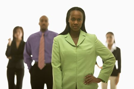 African-American businesswoman with hand on hip with others in background. Stock Photo - 1796830