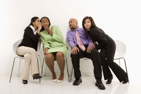 exclude: Multi-ethnic businesswomen whispering and making faces while colleagues eavesdrop.