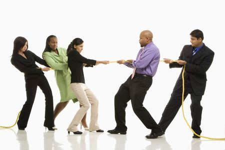against the war: Multi-ethnic businessmen playing tug of war against businesswomen. Stock Photo