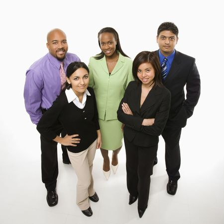 Portrait of multi-ethnic business group standing looking at viewer.