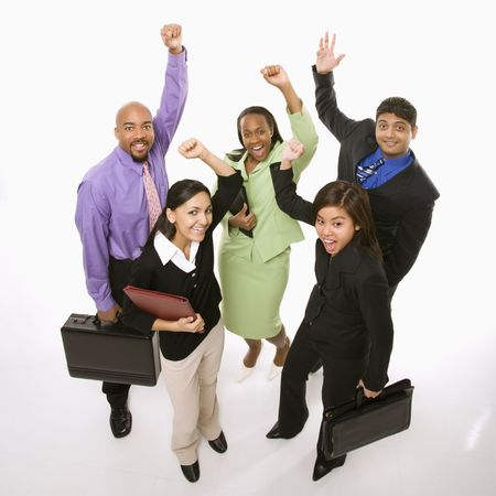 Portrait of multi-ethnic business group standing holding briefcases and cheering. Stock Photo