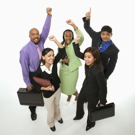 Portrait of multi-ethnic business group standing holding briefcases and cheering. photo