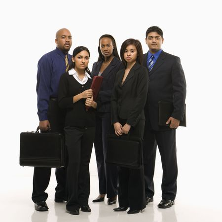 Multi-ethnic business group of men and women standing with briefcases looking at viewer. photo
