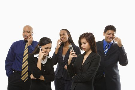 Multi-ethnic business group of men and women standing talking on cell phones. Stock Photo - 1796862
