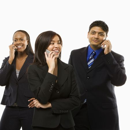 Multi-ethnic businesswomen and businessman standing talking on cell phones. Stock Photo - 1796861