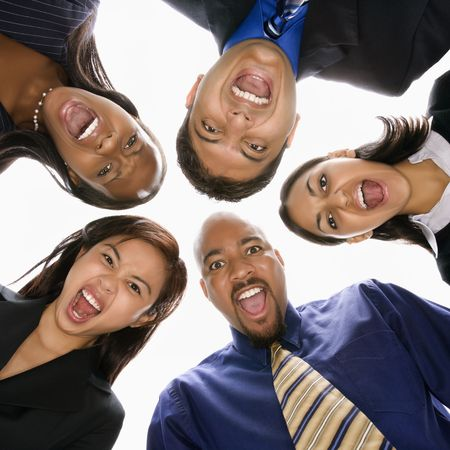 Low angle portrait  of multi-ethnic business group of men and women in huddle screaming.