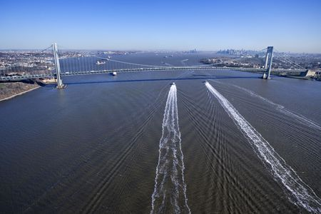 Aerial view of New York Citys Verrazano-Narrows Bridge with boats in water. photo
