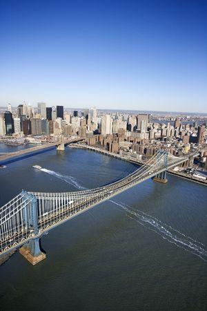 Aerial view of New York City Manhattan Bridge with Brooklyn bridge in background and Manhattan buildings. photo