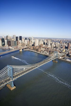 Aerial view of New York City Manhattan Bridge with Brooklyn bridge in background and Manhattan buildings. Stock Photo