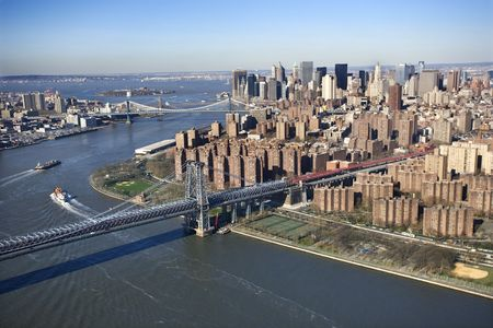 Aerial view of  in New York City Williamsburg Bridge with Manhattan and Brooklyn bridges in background and view of lower east Manhattan.