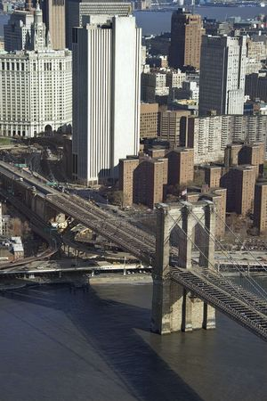 Aerial view of Brooklyn Bridge with Chinatown and New York City buildings. photo