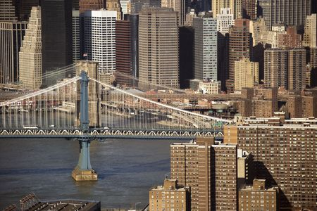 Aerial view of New York Citys Manhattan Bridge with Brooklyn Bridge and Manhattan buildings in background. photo