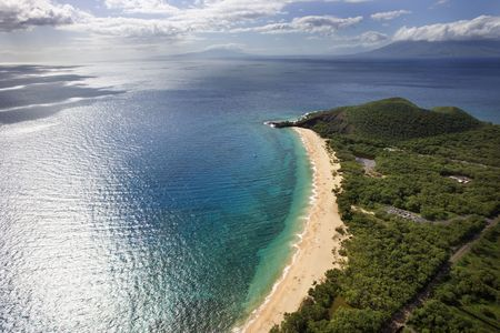 landforms: Aerial of coastline with sandy beach and Pacific ocean in Maui, Hawaii.