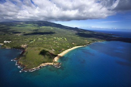 landforms: Aerial of coastline with sandy beach and crater and Pacific ocean in Maui, Hawaii.