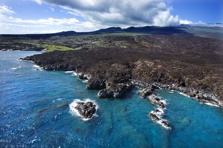 Aerial of Pacific ocean and Maui, Hawaii coast with lava rocks. Stock Photo