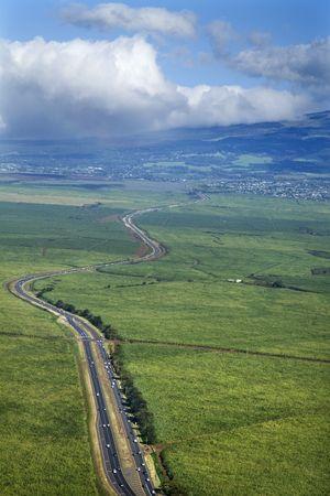 cutting through: Road cutting through cropland in rural Maui, Hawaii.