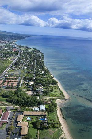 Aerial of Maui, Hawaii coastline with beach and buildings. photo