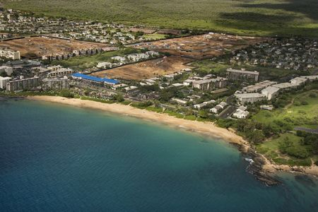 aerial photograph: Aerial of Maui, Hawaii coastline with buildings and beach. Stock Photo