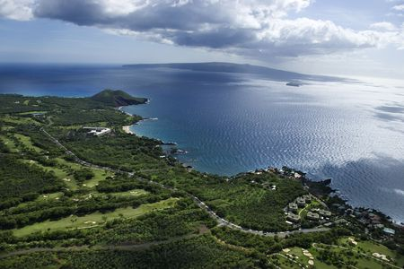 aerial photograph: Aerial of coastline with Pacific ocean with island in background in Maui, Hawaii.