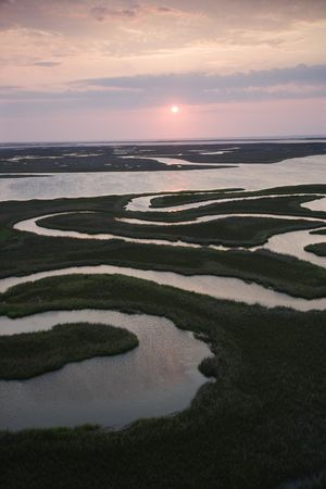 Aerial scenic Bald Head Island North Carolina landscape of marshland during sunrise.