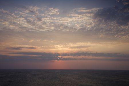 bald head island: Scenic Bald Head Island North Carolina landscape of sunrise over ocean. Stock Photo