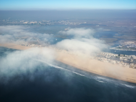 beachfront: Aerial view of clouds covering beachfront in Southern California.