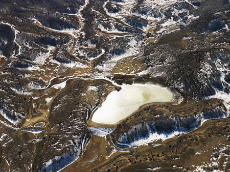 Aerial view of snow covered rural Colorado scenic with lake. photo