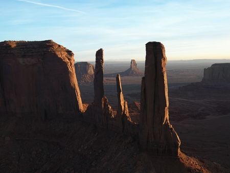 rock formation: Three sisters rock formation in Monument Valley. Stock Photo