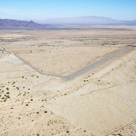 torrid: Aerial view of remote landing strip in California desert.