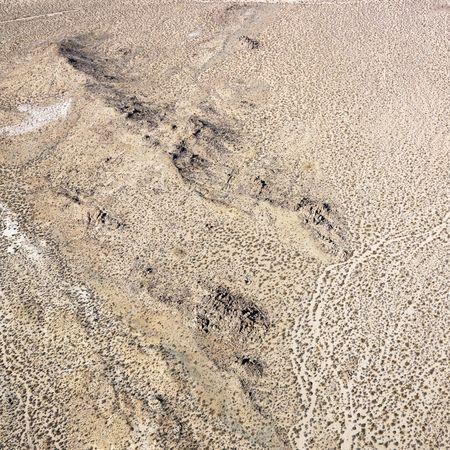 torrid: Aerial view of torrid California desert with rocky landforms.