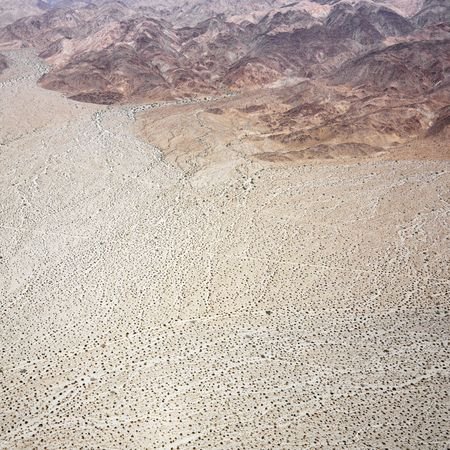 aerial photograph: Aerial view of torrid California desert with rocky landforms.