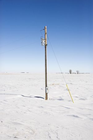Power line in desolate snow covered rural landscape. photo