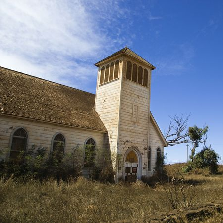Old abandoned white wooden church in Maui, Hawaii.