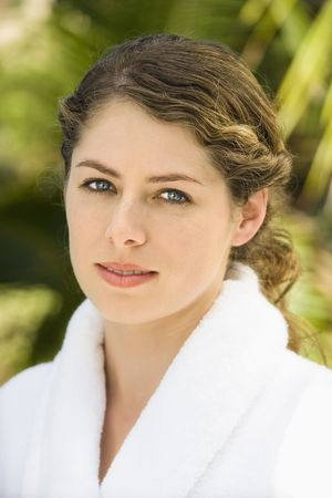 Attractive Caucasian mid-adult woman in white robe smiling. Stock Photo - 1841896