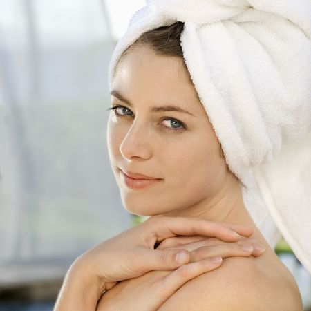 Caucasian mid-adult woman wearing towel around head with hands on shoulder looking at viewer. Stock Photo - 1841853