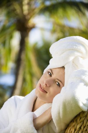 Caucasian mid-adult woman wearing robe with towel on head relaxing in tropical place. Stock Photo - 1841872