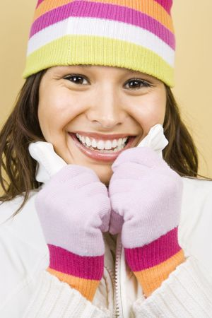 Young adult Caucasian woman wearing winter hat and gloves and smiling at viewer. Stock Photo - 1841955