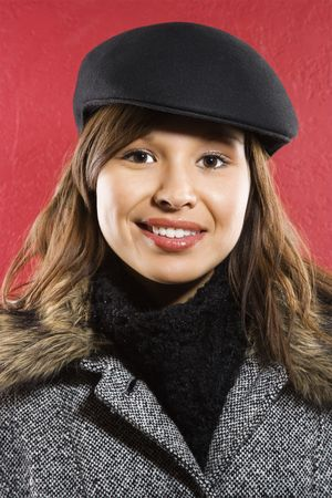 Young adult Caucasian woman wearing flat hat smiling at viewer. Stock Photo - 1842075