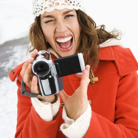 Woman with video camera. photo
