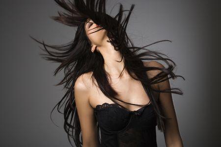 Una mujer con el cabello largo.  Foto de archivo - 1850339