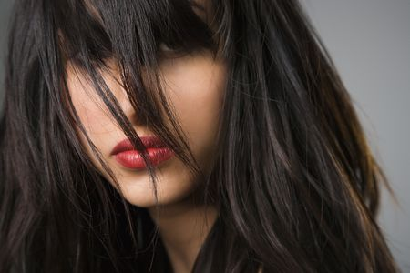 Headshot of pretty young woman with long black hair. photo