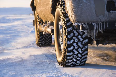 treacherous: Close up of truck on ice covered road. Stock Photo